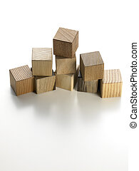 various wooden cubes on a white background - still life of...