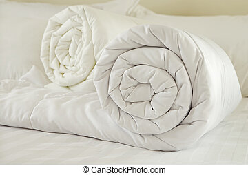 Duvet roll. down filled duvet rolled up isolated on white...