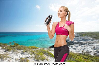 sporty woman drinking water from sportsman bottle - fitness,...