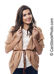 Portrait of fashionable woman in oversized sweater