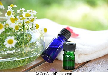 essential oils for aromatherapy with herbal flowers