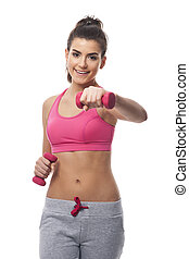 Woman with dumbbells while hard workout