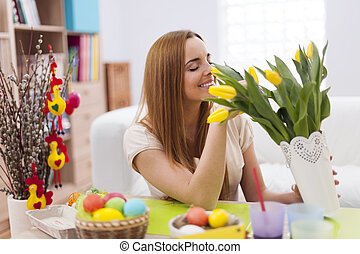 Woman decorating home for easter