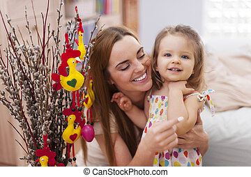 Portrait of mother with daughter in easter time