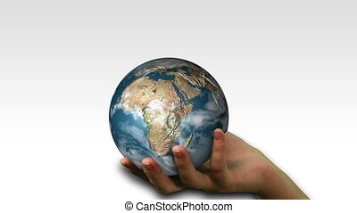 Hand holding a globe rotating
