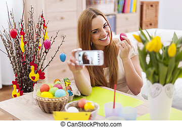 Beautiful woman posing for photo with easter eggs