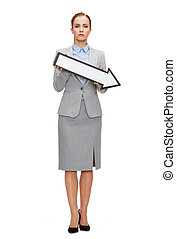 serious businesswoman with direction arrow sign - business...