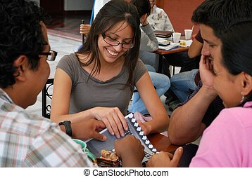 A groupo of  attractive Hispanic students studying together
