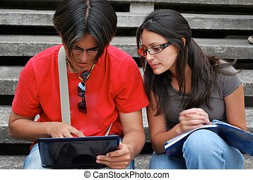 Hispanic students looking at a laptop computer