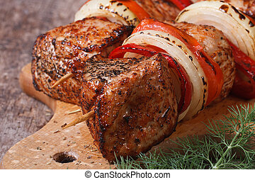two a shish kebab with vegetables on a board. - two a shish...