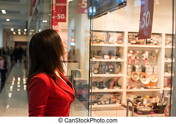 woman looking at the shop window