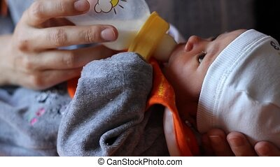 Baby Suckle - Little baby is suckling milk from the baby...