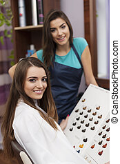 Portrait of hairdresser and customer are ready to dying hair