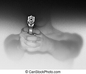 Hand Gun - Photo illustration of a man holding and aiming a...