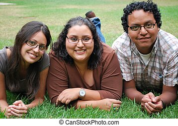 Three Hispanic friends outside