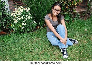 Beatiful Hispanic woman sitting outside