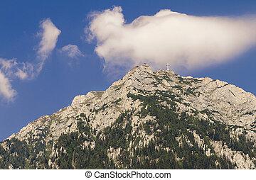 cross on a mountaintop - view of caraiman heroes cross...