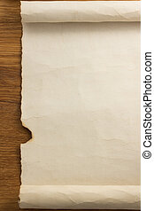 parchment scroll on wood