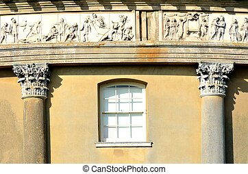 Detail of neo-classical building with olympic frieze