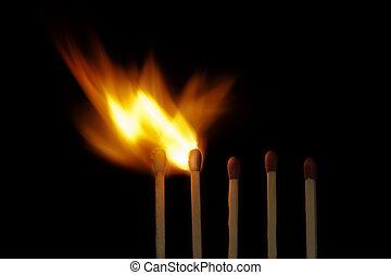 Burning wooden matchsticks - Five wooden matchsticks just...
