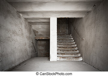 staircase of an old desolate industrial building - the...
