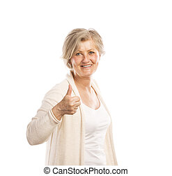 Senior woman - Portrait of a happy senior womanwith thumbs...