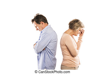 Senior couple - Studio shot of angry senior couple having an...