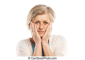 Senior woman suffering from toothache, isolated on white...