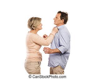 Senior couple - Studio shot of angry senior couple having an...