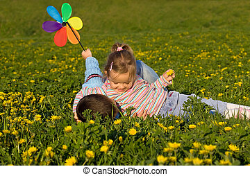 Kids wrestling on the flower field