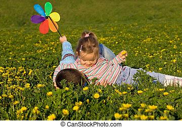 Kids wrestling on the flower field
