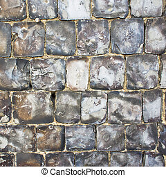 Flint stone wall - Detail of a wall built of flint as a...
