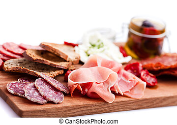 Antipasti and catering platter with different meat and...