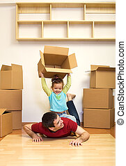 Moving to a new home is fun - kid and father having good...