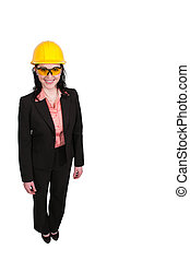 Female Construction Worker wearing a hard hat and safety...