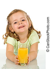 Little girl with fruit juice - Little girl with a large...