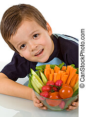 Little boy with fresh vegetables