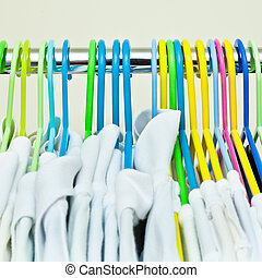 Clothes hangers - Colorful plastic clothes hangers with...