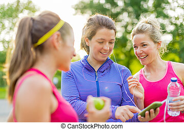 friendship and fitness in the parc - Group of three female...