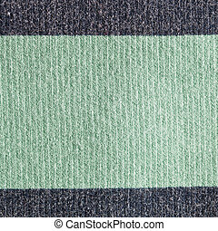 Wool background - Close up of green and grey wool fabric as...