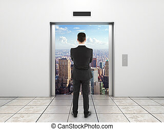 businessman looking at elevator - businessman looking at...