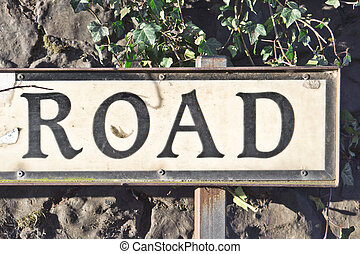 Road sign - The word road on the end of a road sign