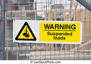 Warning sign - Suspended loads warning sign at a...