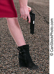 Shooting Yourself in the Foot - A beautiful woman shooting...