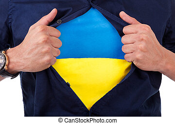 Young sport fan opening his shirt and showing the flag his country ukraine