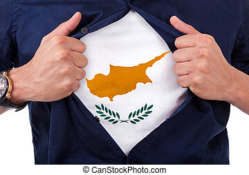 Young sport fan opening his shirt and showing the flag his country Cyprus
