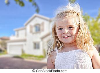 Cute Smiling Girl Playing in Front Yard of House.