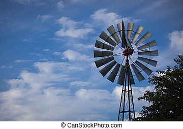 Windmill Against a Deep Blue Sky - Majestic Windmill Against...
