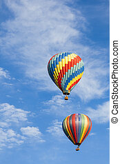 Beautiful Hot Air Balloons Against a Deep Blue Sky and...