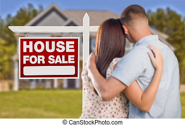 For Sale Real Estate Sign, Military Couple Looking at House